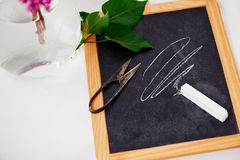 Blackboard with white chalk and scissors Royalty Free Stock Photos