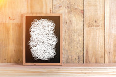 Blackboard with white drawing line with wooden floor and wall ba Royalty Free Stock Photo
