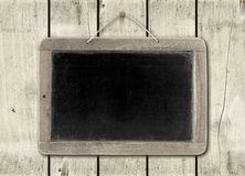 Blackboard on a white wood wall background Stock Photography