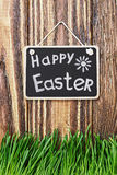 Blackboard with wishes for a happy Easter Stock Photos