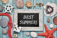 Free Blackboard With `Best Summer` Chalk Text, With Sea Shells, Rope And Star Fish Royalty Free Stock Images - 117800989