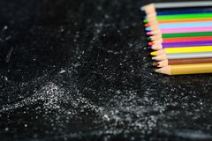 Blackboard With Coloured Pencils Royalty Free Stock Photography