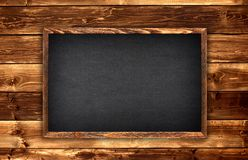 Blackboard on wood royalty free stock photo