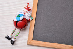 Blackboard on wood background with santa claus and copy space fo Stock Images