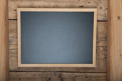 Blackboard on wooden background Stock Photography