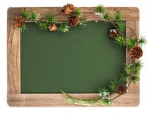 Blackboard with wooden frame and christmas decoration Royalty Free Stock Photography