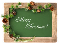 Blackboard with wooden frame and christmas decoration Royalty Free Stock Image