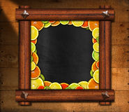 Blackboard with Wooden Frame and Fruit Royalty Free Stock Images