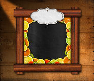 Blackboard with Wooden Frame and Fruit Royalty Free Stock Photography