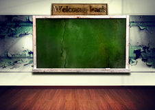 Blackboard with wooden frame on grunge wall Stock Photo