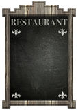 Blackboard with wooden frame and restaurant title Stock Photos