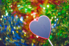 Blackboard wooden heart shape and abstract bokeh Stock Images