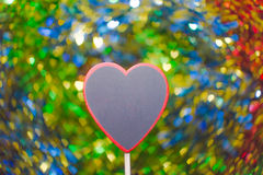 Blackboard wooden heart shape and abstract bokeh Royalty Free Stock Photos