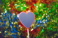 Blackboard wooden heart shape and abstract bokeh Royalty Free Stock Images