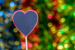 Blackboard wooden heart shape and abstract bokeh. Love abstract background of light with blackboard wooden in heart shape for celebration valentine's day and Royalty Free Stock Photography