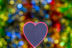 Blackboard wooden heart shape and abstract bokeh. Love abstract background of light with blackboard wooden in heart shape for celebration valentine's day and Royalty Free Stock Images