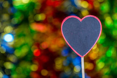 Blackboard wooden heart shape and abstract bokeh. Love abstract background of light with blackboard wooden in heart shape for celebration valentine's day and Stock Photo
