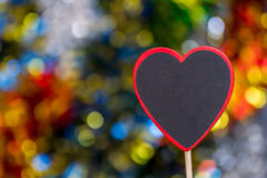 Blackboard wooden heart shape and abstract bokeh. Love abstract background of light with blackboard wooden in heart shape for celebration valentine's day and Stock Image