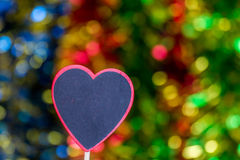 Blackboard wooden heart shape and abstract bokeh. Love abstract background of light with blackboard wooden in heart shape for celebration valentine's day and Royalty Free Stock Photo