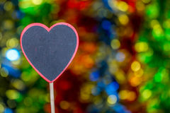 Blackboard wooden heart shape and abstract bokeh. Love abstract background of light with blackboard wooden in heart shape for celebration valentine's day and Stock Photography