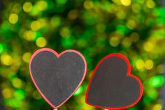Blackboard wooden heart shape and abstract bokeh. Love abstract background of light with blackboard wooden in heart shape for celebration valentine's day and Stock Images