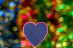 Blackboard wooden heart shape and abstract bokeh. Love abstract background of light with blackboard wooden in heart shape for celebration valentine's day and Stock Photos