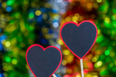 Blackboard wooden heart shape and abstract bokeh. Love abstract background of light with blackboard wooden in heart shape for celebration valentine's day and Royalty Free Stock Photos