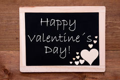 Blackboard With Wooden Hearts, Text Happy Valentines Day Stock Photo