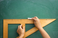 Blackboard and wooden ruler Stock Images