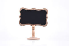 Blackboard on wooden stand isolated on white Royalty Free Stock Image