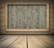 Blackboard on wooden wall Royalty Free Stock Images