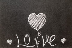 Blackboard with the word love written on it Royalty Free Stock Photo