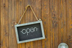 Blackboard with the word open with rope on wooden door of a coff Stock Photography