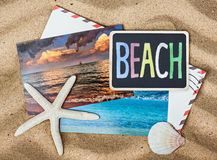 Blackboard with the words beach and photos from vacation Royalty Free Stock Photography