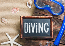 Blackboard with the words diving and swim mask Royalty Free Stock Images