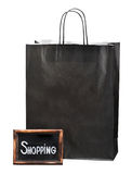 Blackboard with the words and paper shopping bag Stock Images