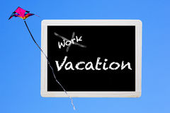 Blackboard with words:'work-vacation' Stock Images