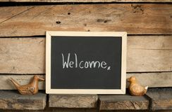 Blackboard writing on wooden background Stock Images