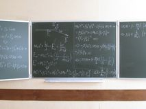 Blackboard written with physical formulas stock image