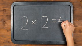 Blackboard with wrong maths equation, stopmotion animation stock video footage