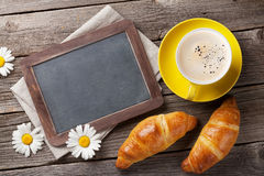 Blackboard for your text, croissants, flowers and coffee Stock Image