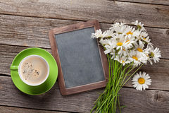 Blackboard for your text, flowers and coffee Stock Image