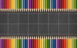 Blackboard z kolorowymi ołówkami Zdjęcia Royalty Free