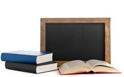 Blackboard z książkami obraz stock
