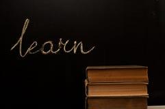 blackboarden lärer den skrivna skolan Royaltyfria Bilder