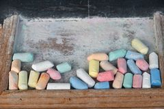 Blackboards and chalk sticks. That are already in use Placed in a wooden box royalty free stock photo