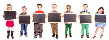 Blackboards. Group of kids holding blackboards stock images