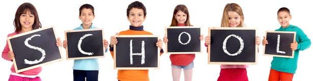 Blackboards. Group of kids holding blackboards isolated in white stock photo