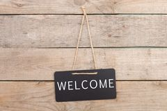 Blackboards with inscription. `Welcome` on wooden background stock photos