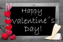 Blackbord noir et blanc, coeurs rouges, jour de valentines heureux Photo stock